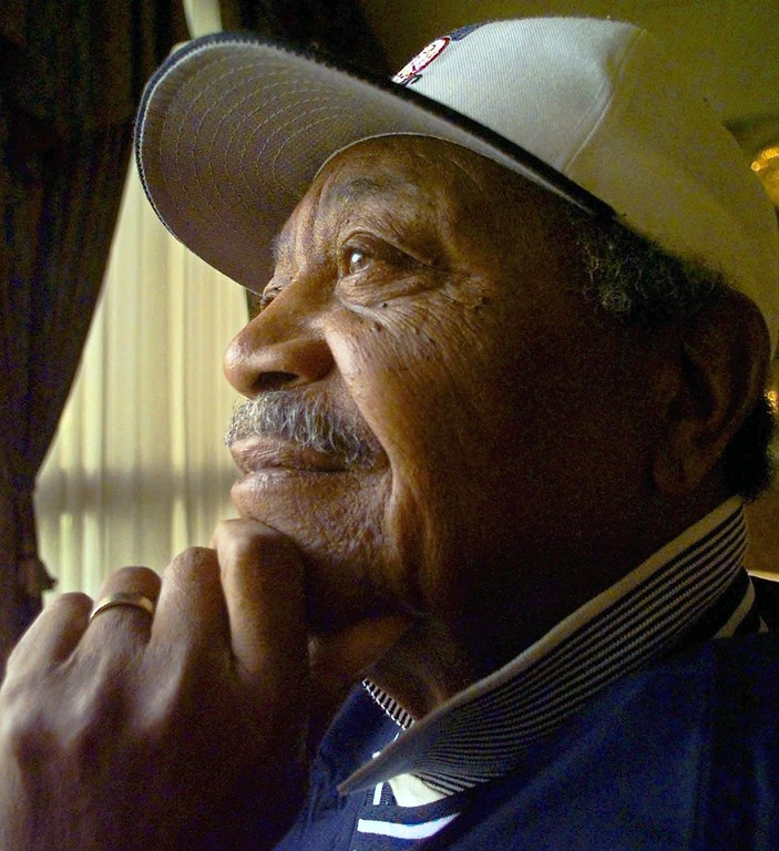 . Larry Doby, the American League legend, poses for a portrait prior to a news conference in Torrance, Calif. shortly after it was announced that he had been elected to the Baseball Hall of Fame Tuesday, March 3, 1998. Doby was the second black player to join the Major Leagues and the first to play in the American League. (AP Photo/Susan Sterner)