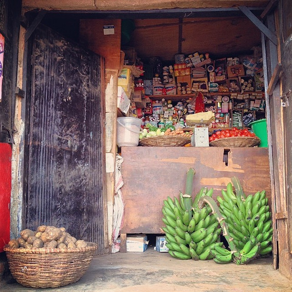 "An ""Africa everything shop"" with ""Irish"" potatoes and requisite green bananas. Taken on the dirt road back streets of Biryogo Market -- Kigali, Rwanda. via Instagram http://ift.tt/SBexmu"