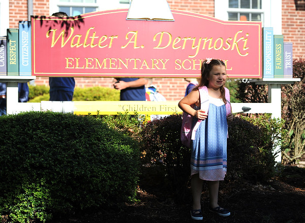 8/29/2019 Mike Orazzi | Staff Chloe Griffis arrives at the Derynoski Elementary School on Southington's first day back this year.