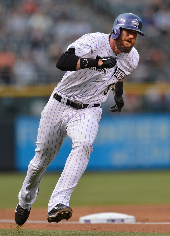 . Colorado Rockies\' Charlie Blackmon rounds third in route to score on a Troy Tulowitzki hit during the first inning of a baseball game against the New York Mets, Friday, May 2, 2014, in Denver. (AP Photo/Jack Dempsey)