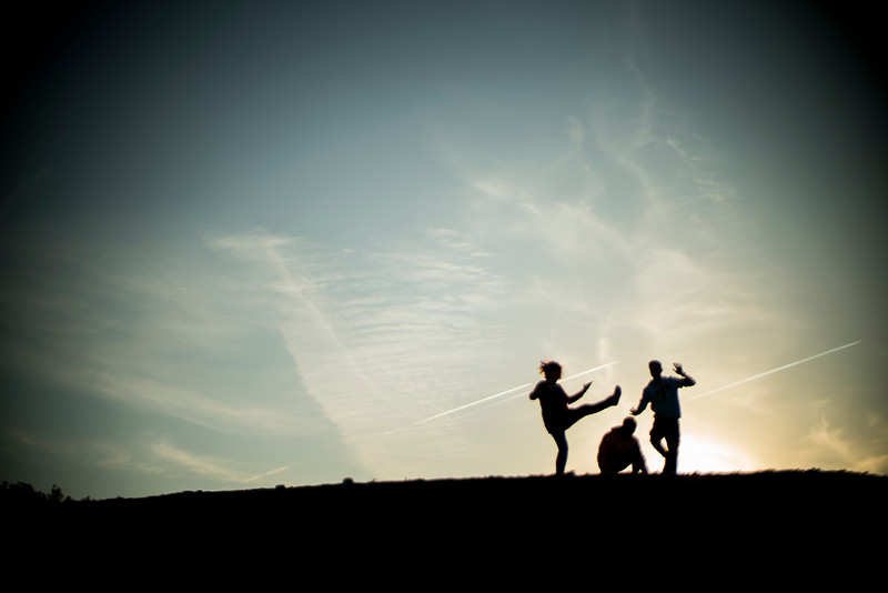 Young people having fun on the top of a hill