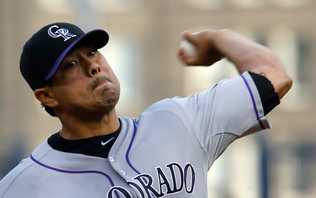 . Colorado Rockies starting pitcher Jorge De La Rosa throws against the Pittsburgh Pirates in the first inning of the baseball game on Saturday, Aug. 3, 2013, in Pittsburgh. (AP Photo/Keith Srakocic)