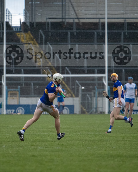Paudie Maher of Tipperary scores a long range point as Seamie Callanan looks on