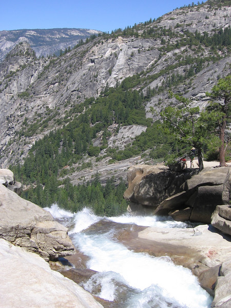 Nevada Fall (Merced River) as it plunges over the edge, taken from the Muir Trail bridge just above the precipice.