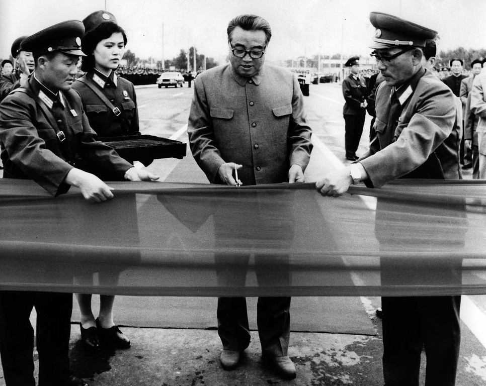 . In this September 1983 photo from North Korea\'s official Korean Central News Agency, distributed by Korea News Service, leader Kim Il Sung cuts the tape at the formal opening of the Bridge of Allegiance in Taedong in Pyongyan, North Korea. (Korean Central News Agency/Korea News Service via AP Images)