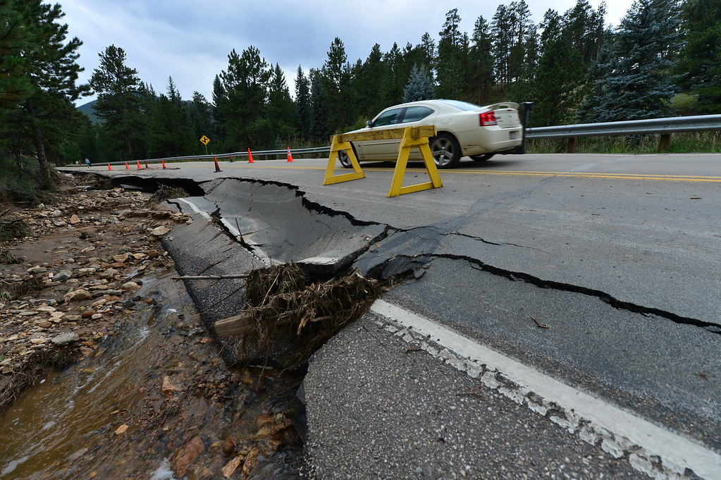 . Part of Spur 66 lays collapsed on Saturday, Sept 14, 2013. The run off from the record rain undercut the road in several places. Walt Hester/Estes Park Trail-Gazette