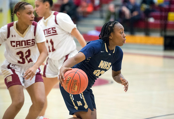 01/0719 Wesley Bunnell | StaffrrNew Britain girls basketball vs Newington at NBHS on Tuesday evening. Raven Simone Jarrett (32) dribbles to the basket looking to pass.