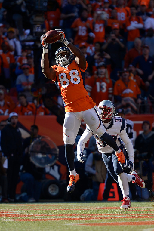 . Denver Broncos wide receiver Demaryius Thomas (88) makes a touchdown catch in the third quarter. The Denver Broncos take on the New England Patriots in the AFC Championship game at Sports Authority Field at Mile High in Denver on January 19, 2014. (Photo by AAron Ontiveroz/The Denver Post)