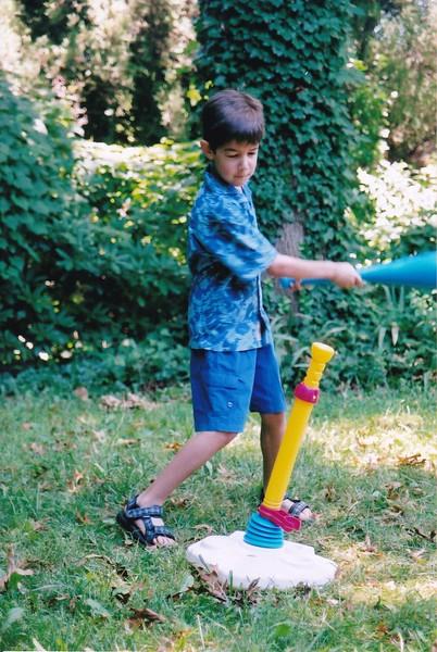 2004-06 Josh swings blue baseball bat.jpg
