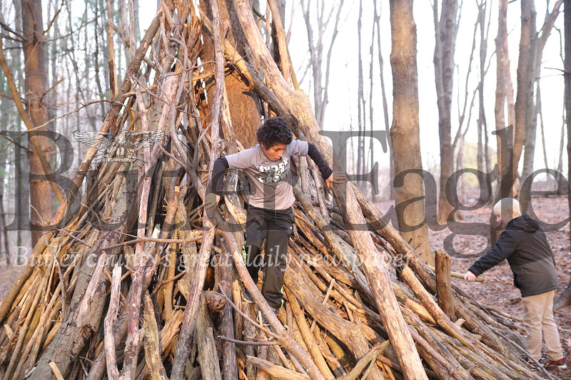 Jayden Herb(left),9, of Mars and Kenny Stahl, 9, of Butler took advantage of Saturday's mild weather to play around the tree forts at Alemeda Park. Seb Foltz/Butler Eagle