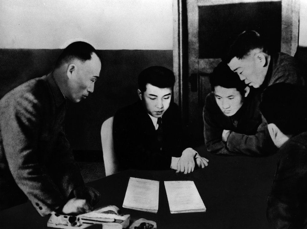 . In this December 1945 photo from North Korea\'s official Korean Central News Agency, distributed by Korea News Service, leader Kim Il Sung (second person from left) debates about the draft of the written decision of the 3rd Central Expansion Committee of the Communist Party of North Korea. (Korean Central News Agency/Korea News Service via AP Images)