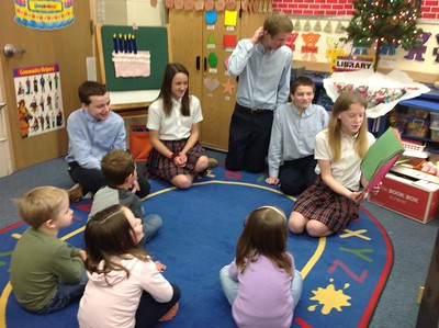 Eighth grade reads to the PreK4 students