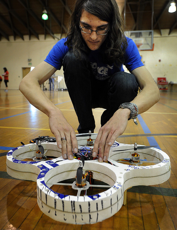 """. Russel Smith checking his quadcopter before competition at this year\'s 28th Annual ME72 Engineering Design Contest, \""""Sponge Wars Attack of the Drones\"""" at Caltech Brown Gym Tuesday, March 13, 2013. Mechanical Engineering 72 competition features teams maneuvering kitchen sponges into a goal with a pair of autonomous robotic vehicles � and preventing opposing teams from doing the same. Six teams  competed head-to-head in a series of rounds. The team with the most points at the end of each heat wins. The victors earn the admiration of the crowds in the stands and are honored with the ME-72 trophy. (Photo by Walt Mancini/SXCity)"""