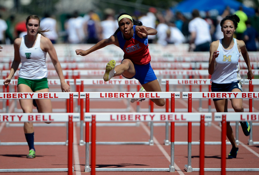 . LITTLETON, CO. - APRIL 27TH: Ashley Miller, center, Cherry Creek, edges out Erin Bowers, ThunderRidge High School, left, and Taylor Klein, Mullen High School, in the girls 100 meter hurdles during the 2013 Liberty Bell Track Meet at Littleton Public Schools Stadium Saturday, April 27th, 2013. (Photo By Andy Cross/The Denver Post)