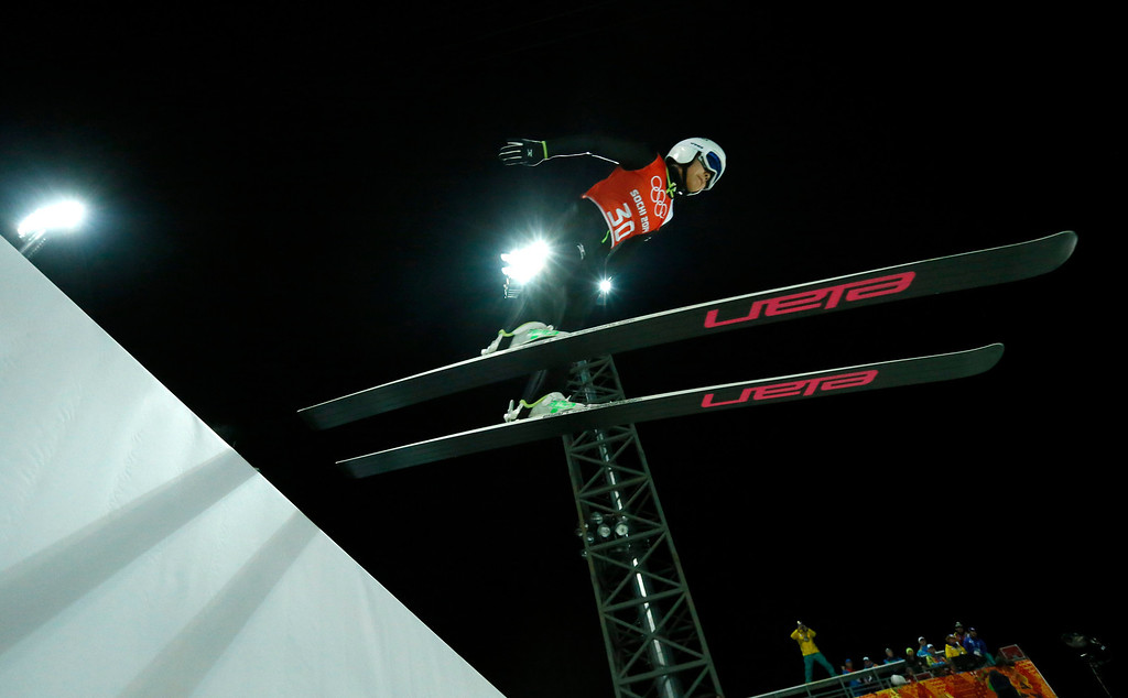 . Japan\'s Sara Takanashi makes an attempt during a women\'s normal hill ski jumping training at the 2014 Winter Olympics, Monday, Feb. 10, 2014, in Krasnaya Polyana, Russia. (AP Photo/Dmitry Lovetsky)