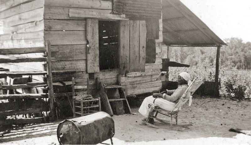 ". Old Aunt Julia Ann Jackson, age 102 and the corn crib where she lives. Between 1937 and ca. 1938. She uses the large battered tin can for a stove and does her cooking on it. Aunt Julia Ann is an ex-slave and was grown woman when the Civil ""Wah broke out.\"" Library of Congress"