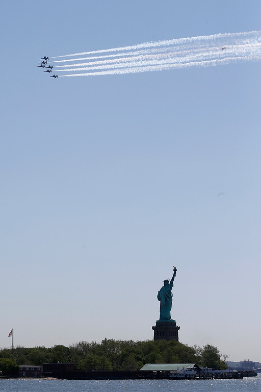 . Six U.S. Air Force Thunderbirds, seen from Liberty State Park, Friday, May 22, 2015, in Jersey City, N.J., fly over the Statue of Liberty while conducting a flyover photo mission. (AP Photo/Julio Cortez)