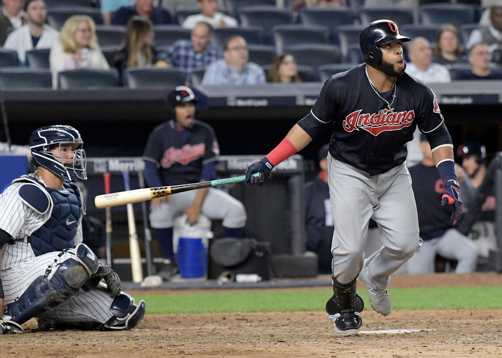 . Cleveland Indians\' Carlos Santana hits a home run as New York Yankees catcher Gary Sanchez, left, looks on during the seventh inning of a baseball game Monday, Aug. 28, 2017, at Yankee Stadium in New York. (AP Photo/Bill Kostroun)