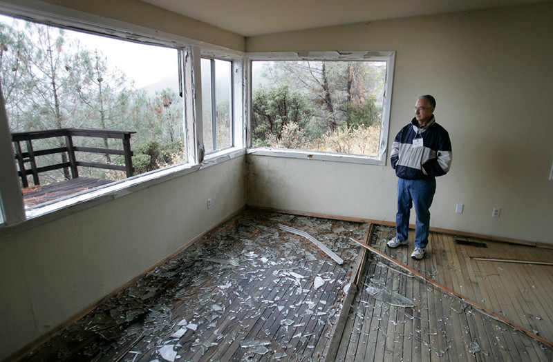 . 2008: Charles Aftosmis, the commander of the 682nd Radar Squadron from 1974-76, looks over what remains of the house he lived in at the time.  (Patrick Tehan/Mercury News)