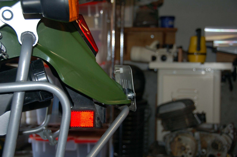 Several variations of license plate mounts.  Vertical with one Lite 'n bolt.