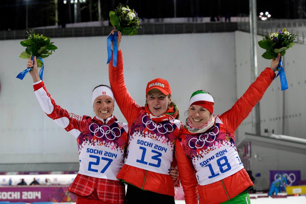. Silver medalist Switzerland\'s Selina Gasparin, left, gold medalist Belarus\' Darya Domracheva, center, and bronze medalist Belarus\' Nadezhda Skardino pose after the women\'s biathlon 15k individual race, at the 2014 Winter Olympics, Friday, Feb. 14, 2014, in Krasnaya Polyana, Russia. (AP Photo/Lee Jin-man)