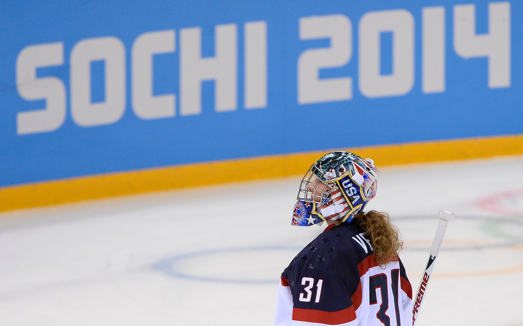 . US goalkeeper Jessie Vetter skates on the ice at timeout during the Women\'s Ice Hockey Group A match between Canada and USA at the Sochi Winter Olympics on February 12, 2014 at the Shayba Arena. AFP PHOTO / JONATHAN NACKSTRAND/AFP/Getty Images