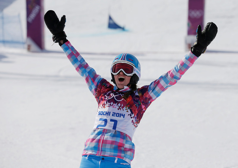 . Russia\'s Alena Zavarzina celebrates after winning the bronze medal in the women\'s snowboard parallel giant slalom final at the Rosa Khutor Extreme Park, at the 2014 Winter Olympics, Wednesday, Feb. 19, 2014, in Krasnaya Polyana, Russia. (AP Photo/Andy Wong)