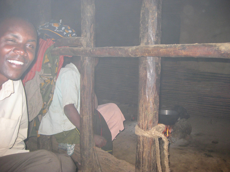 Typical home: We are in the area where the cows spend the night; the family lives and cooks through the railing.