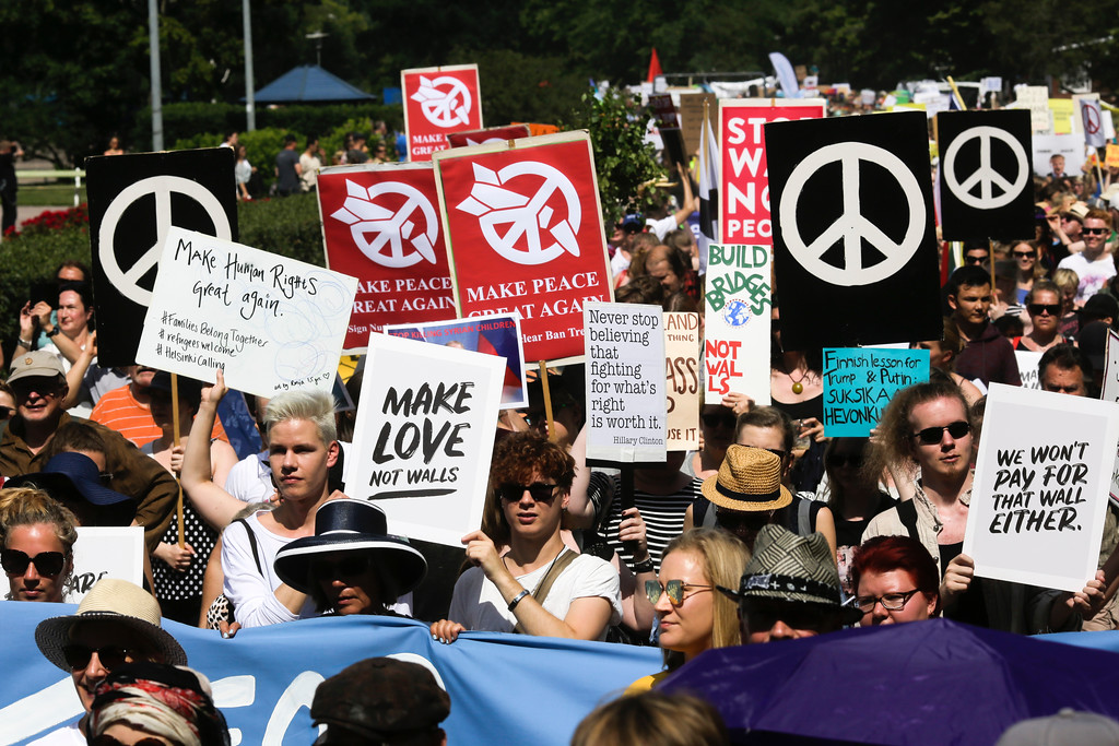 . Protestors attend a rally against the policy of U.S. President Donald Trump and Russian President Vladimir Putin in Helsinki, Sunday, July 15, 2018. President Trump and President Putin will meet in Finland\'s capital on Monday, July 16, 2018. (AP Photo/Markus Schreiber)
