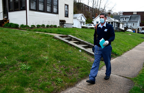 4/18/2020 Mike Orazzi | Staff United States Postal Service Letter Carrier Todd Dabkowski delivers mail along Stanley Street in New Britain on Saturday.