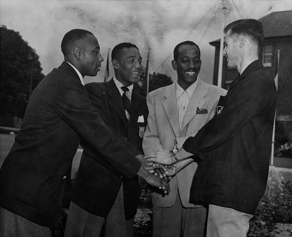 ". Members of the U.S. Olympic 4 x 100-meter relay team were disqualified Aug. 7, 1948 as winners of the event when an Olympic judge ruled the first passing of the baton was not made within the 20-meter passing zone.  They get together at the Uxbridge, England Olympic camp for a victory handshake, Aug. 10, after learning the decision was reversed, making them winners of the event.  Left to right are: Norwood ""Barney\"" Ewell, Lancaster, Pa.; Lorenzo Wright, Detroit, Mich.; Harrison Dillard, Cleveland, Oh., and Melvin Patton, of Los Angeles, Calif.(AP Photo)"