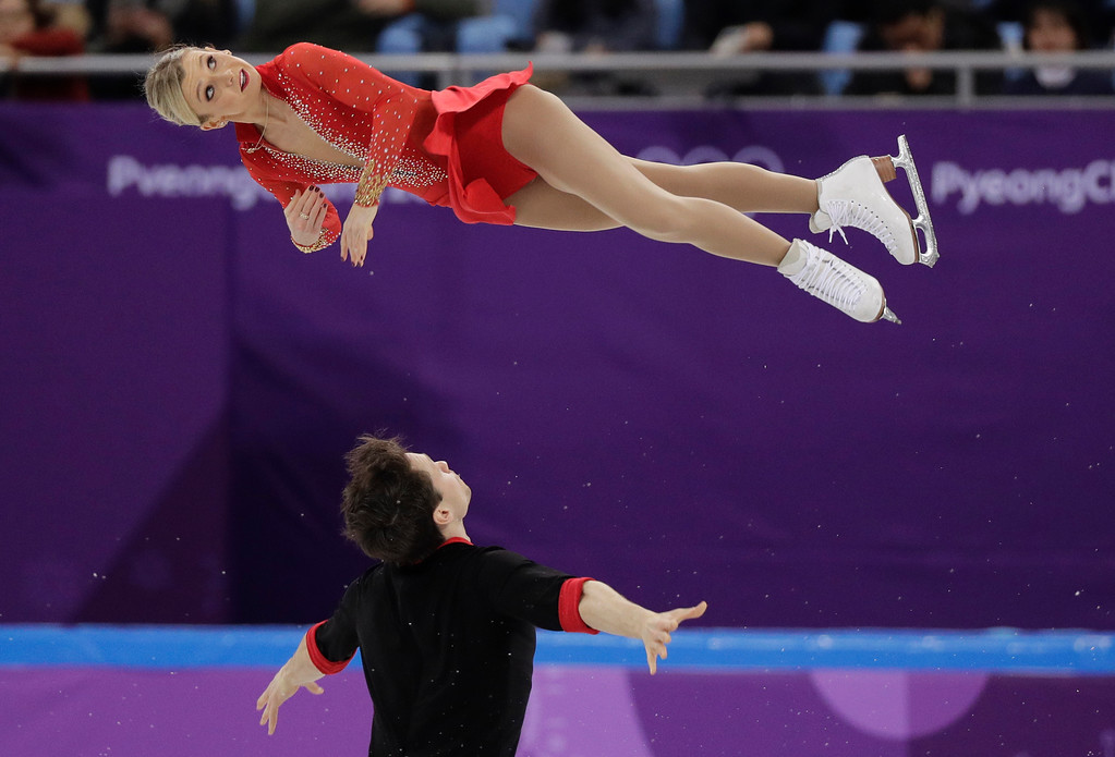 . Kirsten Moore-Towers and Michael Marinaro of Canada perform in the pair figure skating short program in the Gangneung Ice Arena at the 2018 Winter Olympics in Gangneung, South Korea, Wednesday, Feb. 14, 2018. (AP Photo/David J. Phillip)
