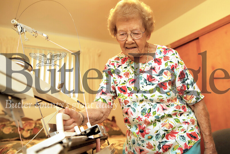 At 98 -- soon to be 99-- Eleanor Hendler still prefers to stand while knitting. Seb Foltz/Butler Eagle 07/23/19