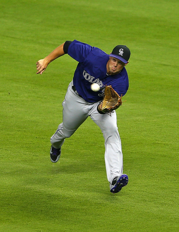 . Michael Cuddyer #3 of the Colorado Rockies makes a catch during Opening Day against the Miami Marlins at Marlins Park on March 31, 2014 in Miami, Florida.  (Photo by Mike Ehrmann/Getty Images)