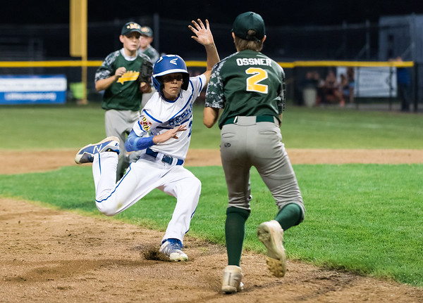 08/10/18 Wesley Bunnell | Staff Maryland defeated New Jersey in a Little League Mid-Atlantic semi final game on Friday evening at Breen Field. Maryland's Lukas Loring (24) is caught in a run down to end the inning and tagged by New Jersey's Leland Ossner (2).