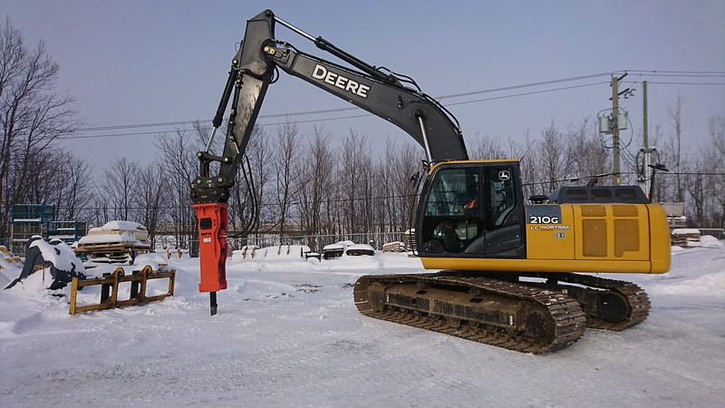 NPK GH9 hydraulic hammer with enclosed bracket on Cat excavator - Nortrax Canada  1-18.JPG