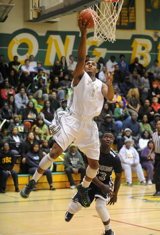 . 02-19-2012--(LANG Staff Photo by Sean Hiller)- Mayfair at Poly in the second round of the Division I-AA boys basketball playoffs Tuesday night. Poly\'s Roschon Prince sails for a first quarter basket.