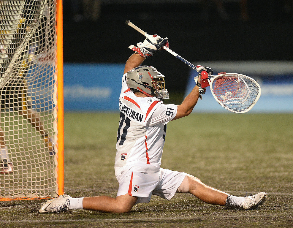 . United States goalie Jesse Schwartzman did the splits attempting to make a save late in the fourth quarter. The United States defeated the Iroquois Nationals 18-5 Tuesday night, July 15, 2014.   Photo by Karl Gehring/The Denver Post