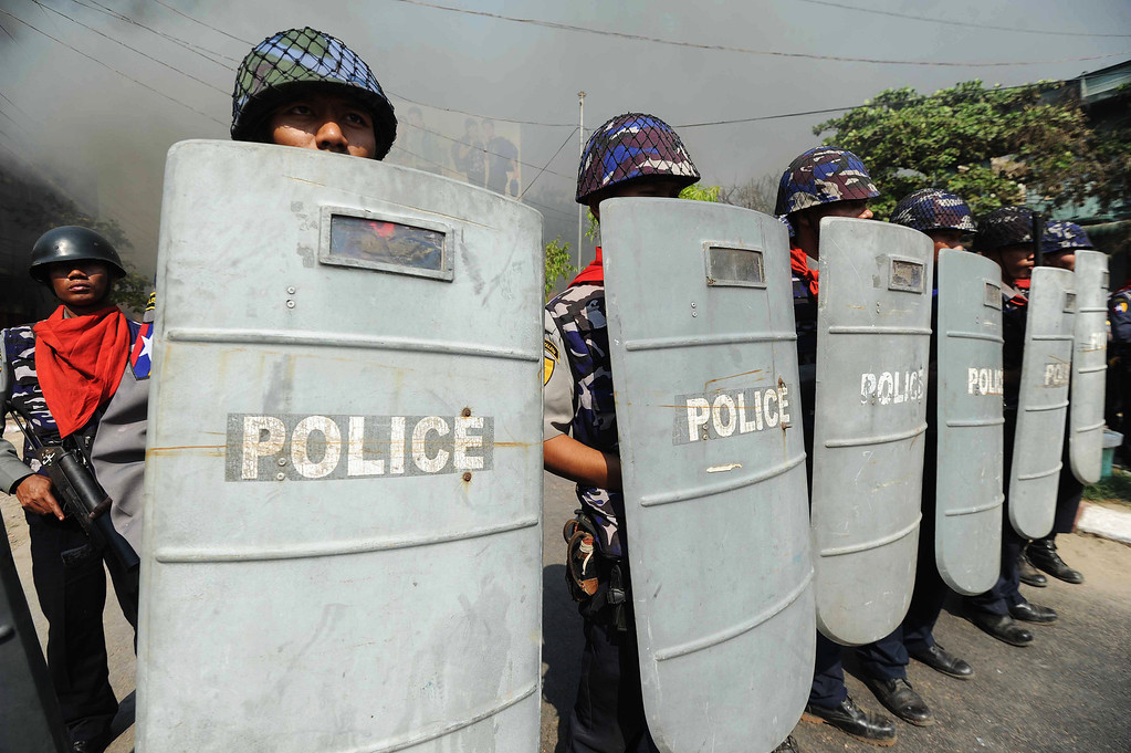 . Policemen stand guard in a street in riot-hit Meiktila, central Myanmar on March 22, 2013.   AFP PHOTO/ Soe Than WINSoe Than WIN/AFP/Getty Images