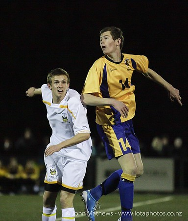 Harry Smith and Thed Young vie for the ball at the Wellington Boys Youth Championship Premier Football Final (Trevor Rigby Cup)  between Wellington College and Rongatai College played at Wellington College, Wellington, New Zealand on 23 August 2012. Photo: john.mathews @xtra.co.nz