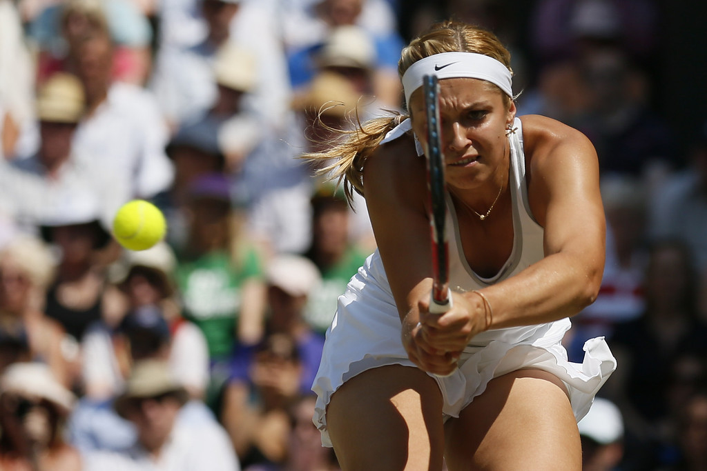 . Germany\'s Sabine Lisicki returns against France\'s Marion Bartoli in their women\'s singles final match on day twelve of the 2013 Wimbledon Championships tennis tournament at the All England Club in Wimbledon, southwest London, on July 6, 2013.  STEFAN WERMUTH/AFP/Getty Images