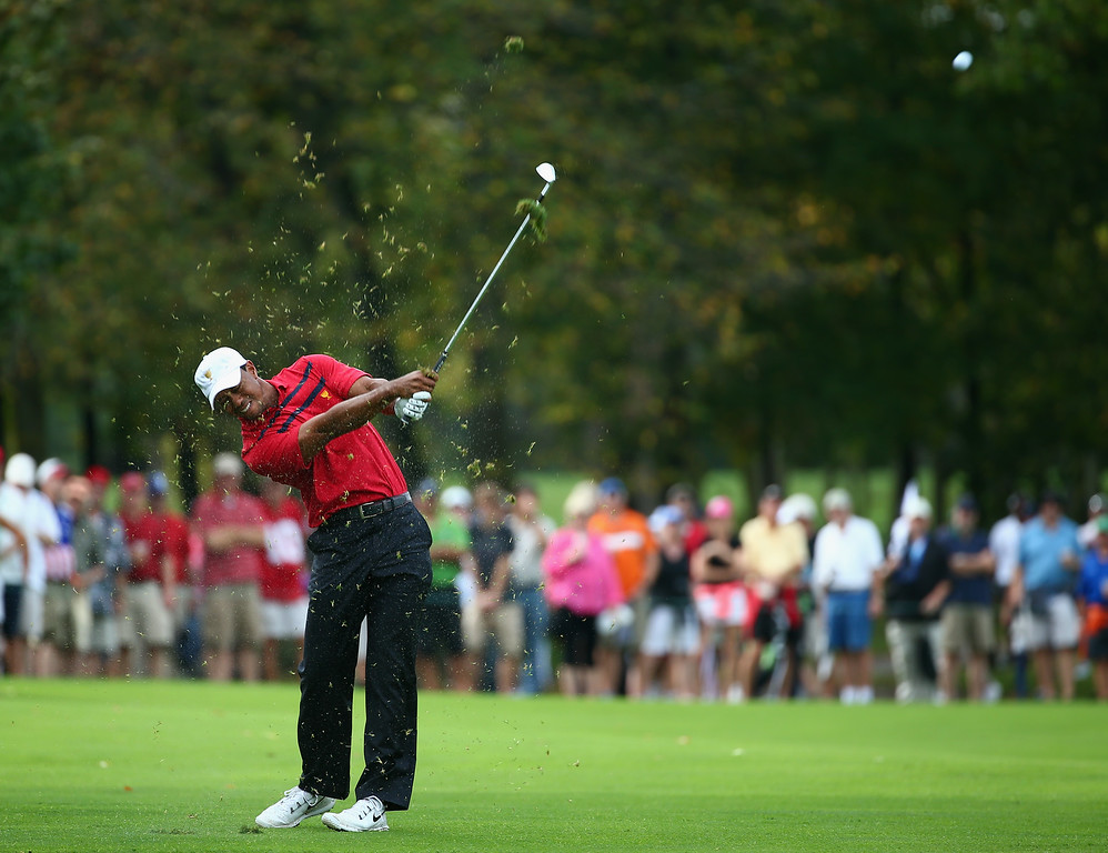 . DUBLIN, OH - OCTOBER 05:  Tiger Woods of the U.S. Team hits his second shot on the 13th hole during the Day Three Four-ball Matches at the Muirfield Village Golf Club on October 5, 2013  in Dublin, Ohio.  (Photo by Andy Lyons/Getty Images)