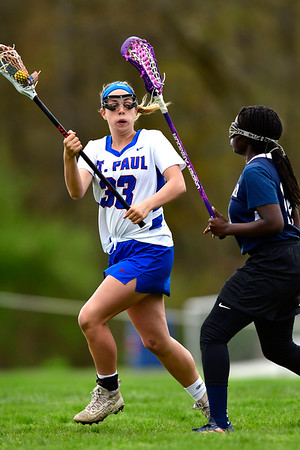 5/2/2019 Mike Orazzi | Staff St. Paul's Ashley Suzio (33) during Thursday's girls lacrosse with Amistad in Bristol.