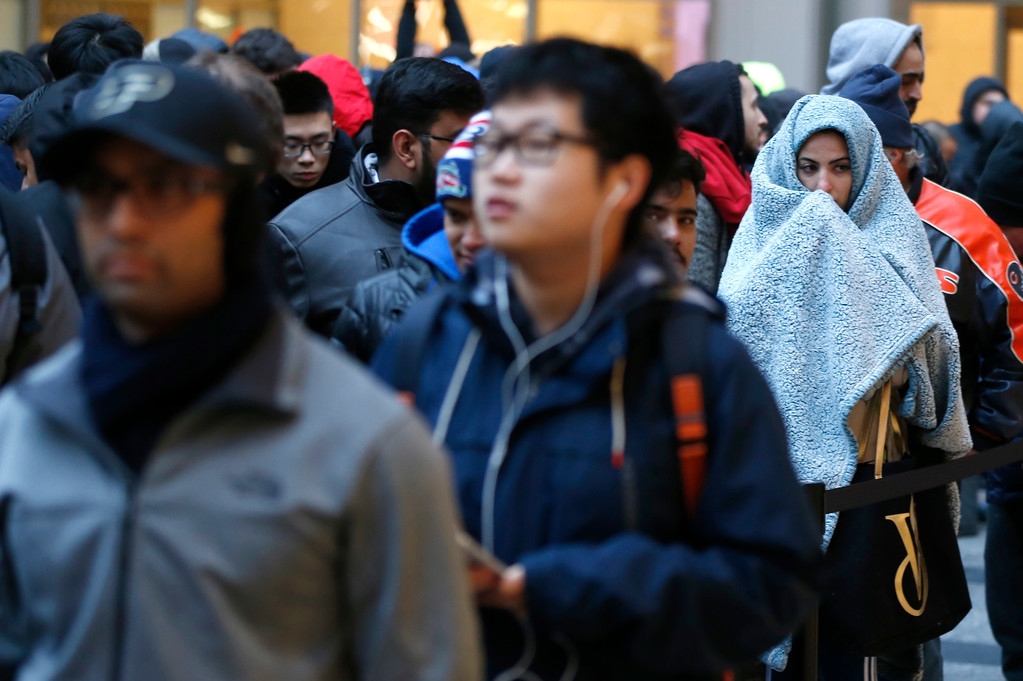 . Consumers line up to buy the Apple iPhone X at the new Apple Michigan Avenue store along the Chicago River Friday, Nov. 3, 2017, in Chicago. (AP Photo/Charles Rex Arbogast)