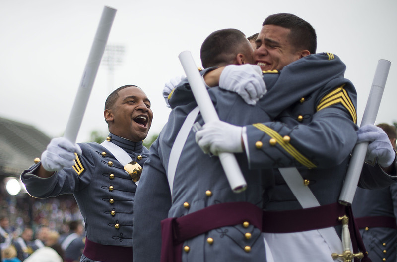 . Members of the 2014 graduating class at the United States Military Academy at West Point, New York, hug at the end of the ceremony May 28, 2014. (JIM WATSON/AFP/Getty Images)