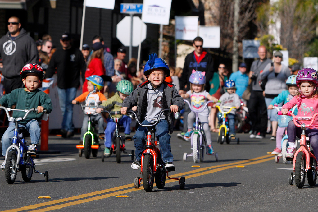 . Collin Randolph, 3, center, of Yucaipa, participates in the public race portion of the Redlands Bicycle Classic on Saturday, April 5, 2014 in Redlands, Ca.  (Photo by Micah Escamilla for the Redlands Daily Facts)