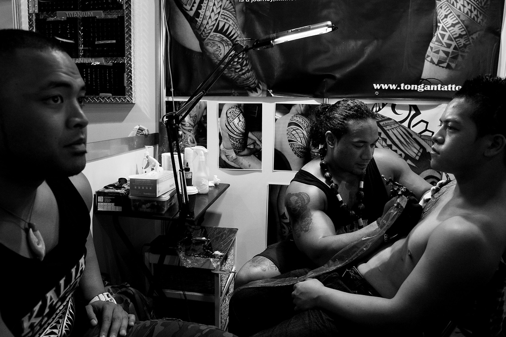 . Tattoo artist Carl Cocker of \'Kalia Tattoo NZ\' works on a young man during The Australian Tattoo & Body Art Expo at the Royal Hall of Industries, Moore Park on March 8, 2013 in Sydney, Australia. The annual three day event showcases some of Australia\'s best tattoo and body artists and is open to enthusiasts March 8-10.  (Photo by Lisa Maree Williams/Getty Images)
