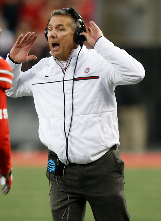 . Ohio State head coach Urban Meyer shouts to his team against Illinois during the first half of an NCAA college football game Saturday, Nov. 18, 2017, in Columbus, Ohio. (AP Photo/Jay LaPrete)