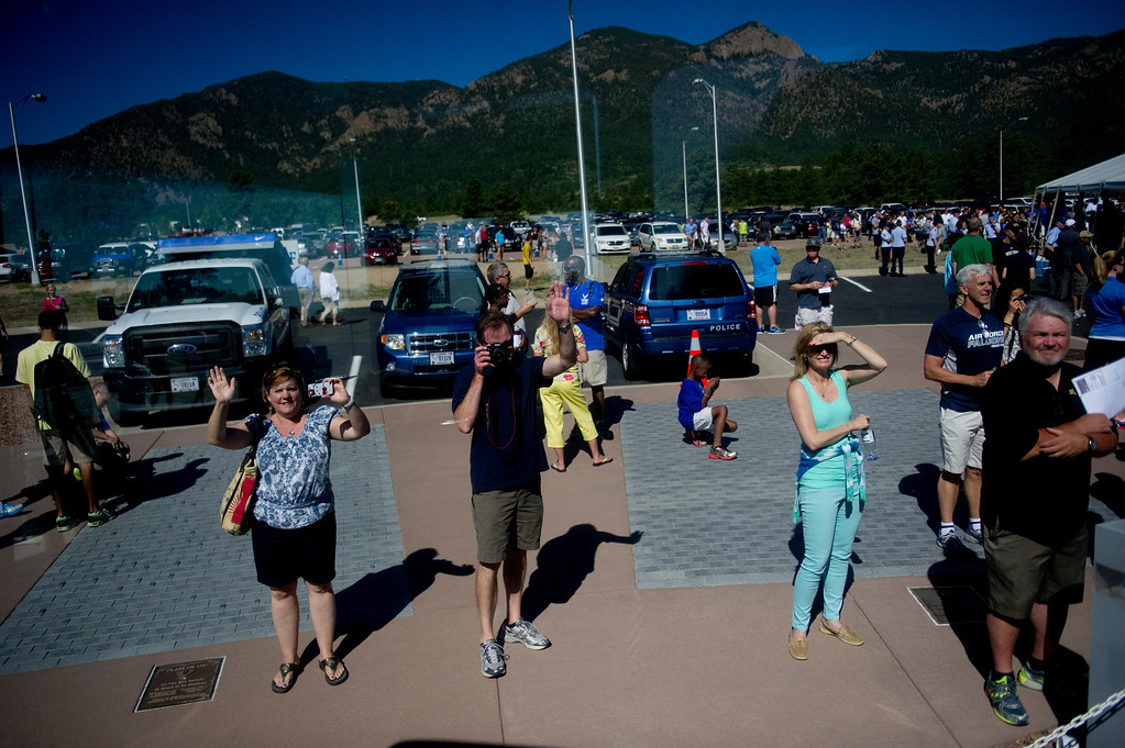 . COLORADO SPRINGS, CO. - JUNE 27: Parents and family members wave goodbye to their children as they take a bus to the central campus of the Air Force Academy for inprocessing as the class of 2017 on June 27, 2013. (Photo By Grant Hindsley/The Denver Post)