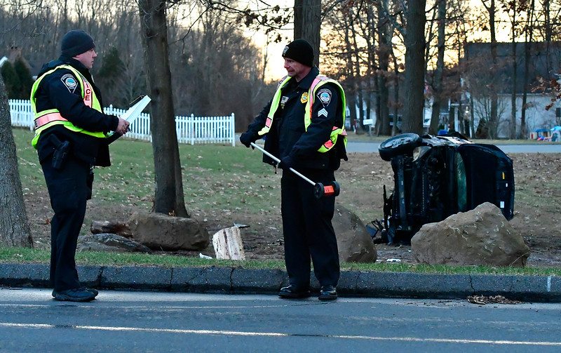 1/10/2018 Mike Orazzi | Staff The scene of a one-car rollover crash at the intersection of Lazy Lane and Curtiss Street in Southington Thursday afternoon. A good samaritan pulled the driver from the burning vehicle before police and fire departments arrived.